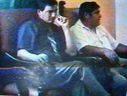 regidor Julián Molina, y Jsé Rey sentados juntos en reunion de transportitas de Chancay.